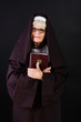 friendly nun holding bible