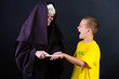 nun hits boy with a ruler