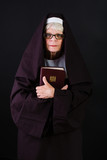 Nun holding bible
