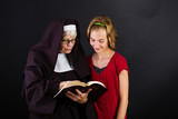 nun reading bible to a child