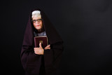 nun holding a bible