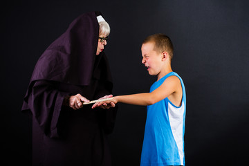 Nun hitting child with a ruler