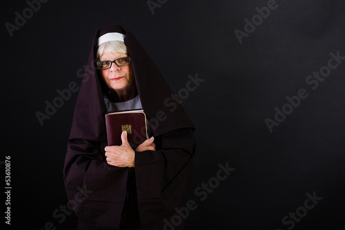 nun holding a bible