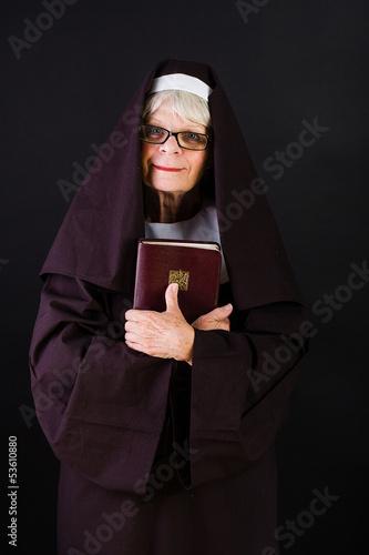 friendly nun holding bible