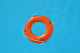 life preserver orange in a swimming pool