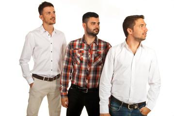 Three business men looking away
