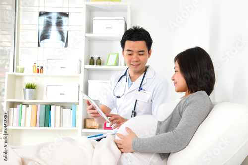 chinese mother pregnant medical checkup with doctor