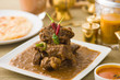 Постер, плакат: mutton korma famous food with traditional indian background item