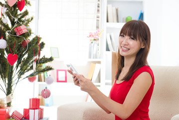 asian girl during christmas with her presents