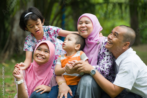 lifestyle photo of malay family having fun in the park ,malaysia