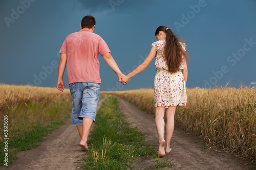 couple walking the road