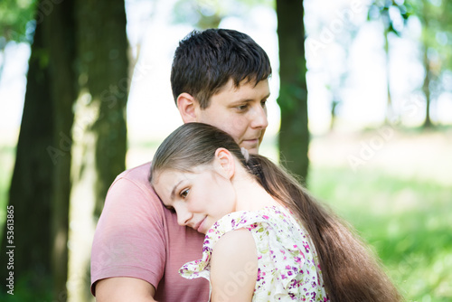 man and a woman hugging