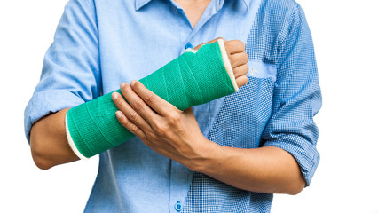 Green cast on an arm of a women isolated