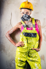 Female construction worker wearing respirator posing indoors