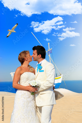 Bride and groom on Santorini island