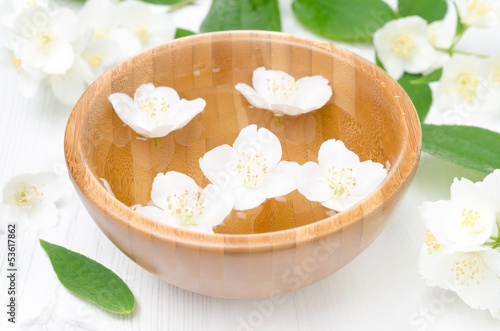 jasmine flowers in a wooden bowl for spa and aromatherapy