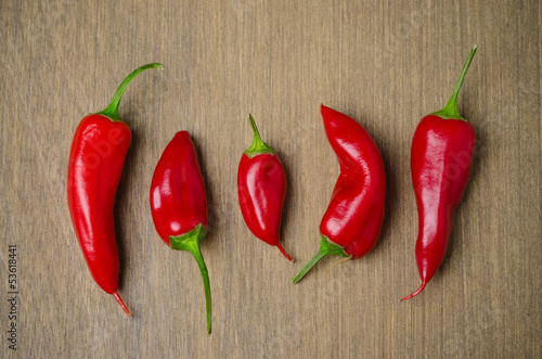 red hot chili peppers on a brown wooden background