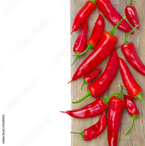 red hot chili peppers on a wooden board, isolated, close-up