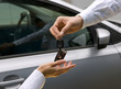 woman receiving car key from man