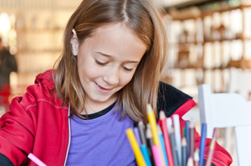 young girl at work, in classroom or library