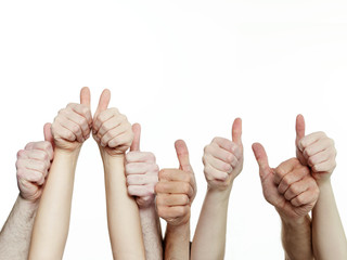 Close up of hands showing thumbs up