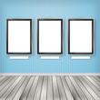 Three empty frames on a wall