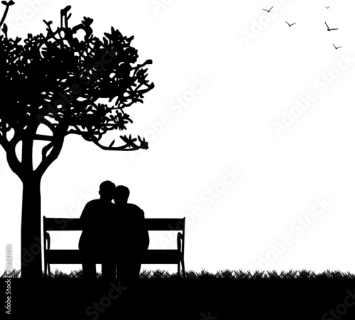 Lovely retired elderly couple sitting on bench in park