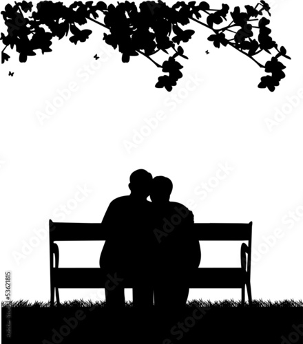 Retired elderly couple sitting on bench in garden or yard