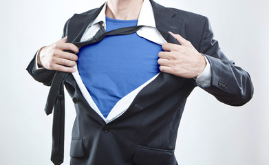 Closeup of a businessman showing the superhero suit under his sh