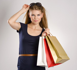Portrait of lovely fresh shopping woman holding bags