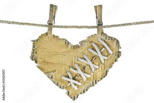 """The cardboard heart with lacing on a clothesline"""