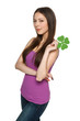 Young female holding shamrock leaf symbol