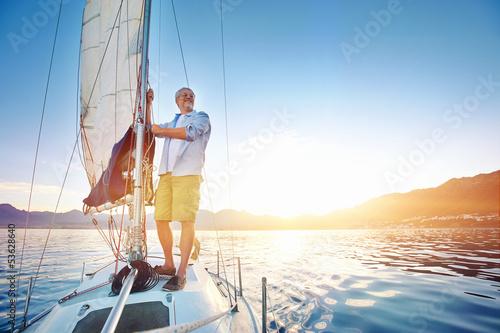 Leinwanddruck Bild sunrise sailing boat