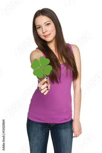 Young female giving you shamrock leaf