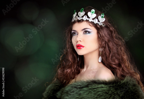 Beautiful woman luxury portrait with long hair in fur coat. Jewe