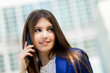 Young businesswoman talking at the phone