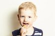 smiling child. cute kid boy eating ice cream.