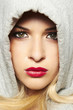 beautiful blond woman in hood. red lips