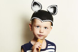 child. cute kid boy eating ice cream in studio