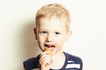 smiling child. cute kid boy eating ice cream.