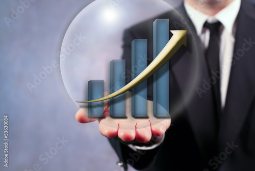 Businessman Holding Rising Bar Graph
