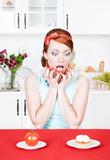 Screaming woman choosing between tomato and cake