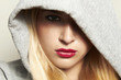 beautiful blond woman in hood. red lips.