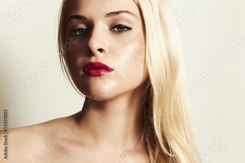 beautiful blond woman with red lips.