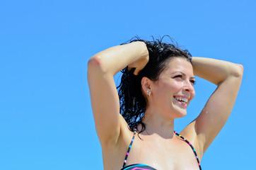 Smiling girl holding up her hair