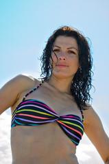 Beautiful woman with wet hair in a bikini