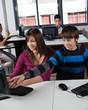 Teenage Schoolboy Pointing At Computer Monitor