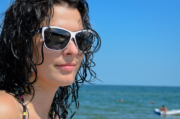 Beautiful woman with wet hair and sunglasses