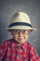 boy in a cap and glasses