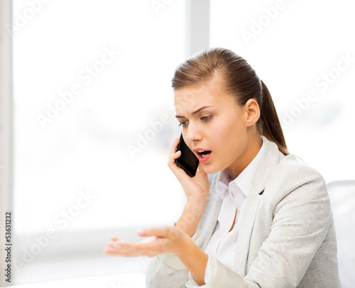 woman shouting into smartphone